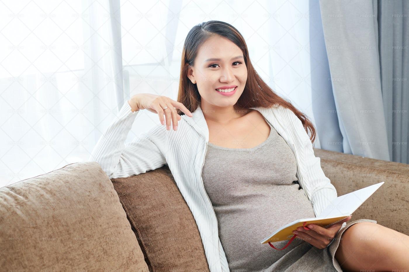 Pregnant Woman Checking Gratitude: Stock Photos
