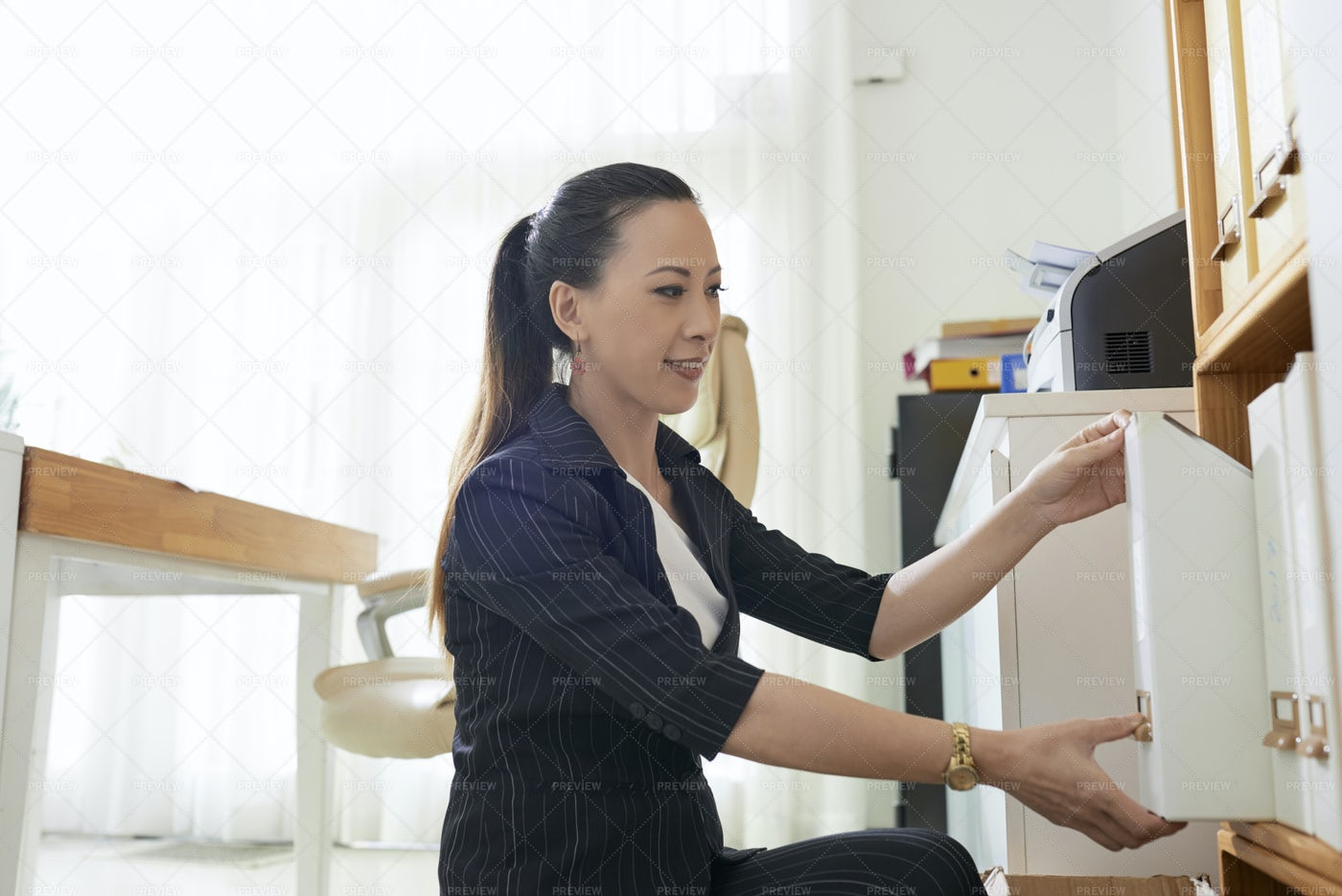 Businesswoman Working With Archive: Stock Photos