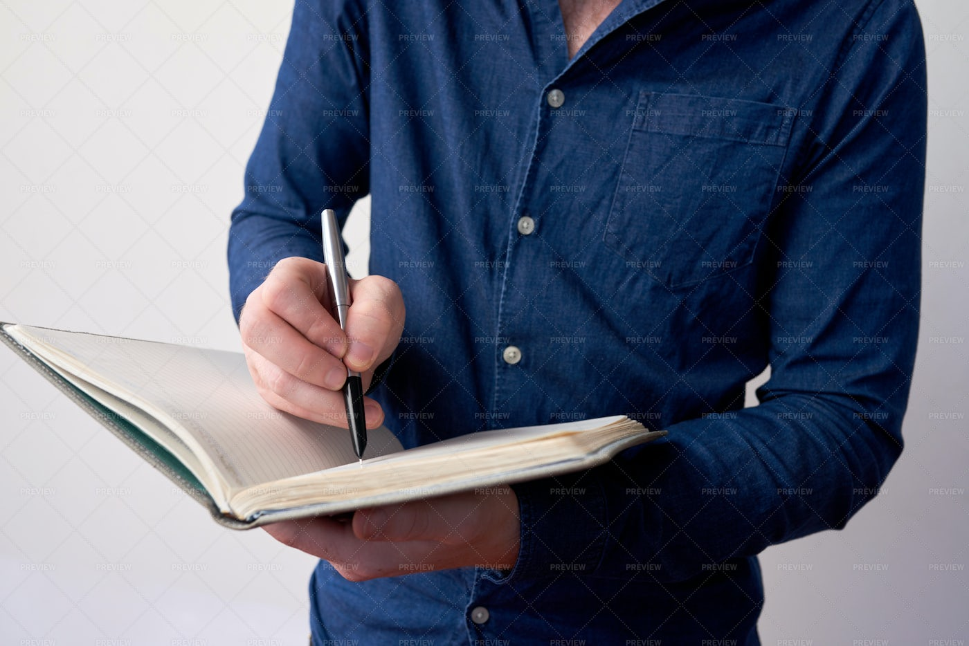 Businessman Writing In Planner: Stock Photos