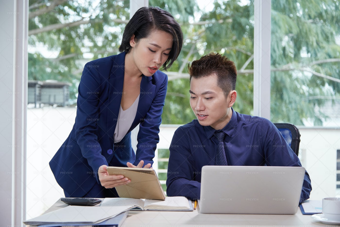 Businessman With Secretary Working At: Stock Photos