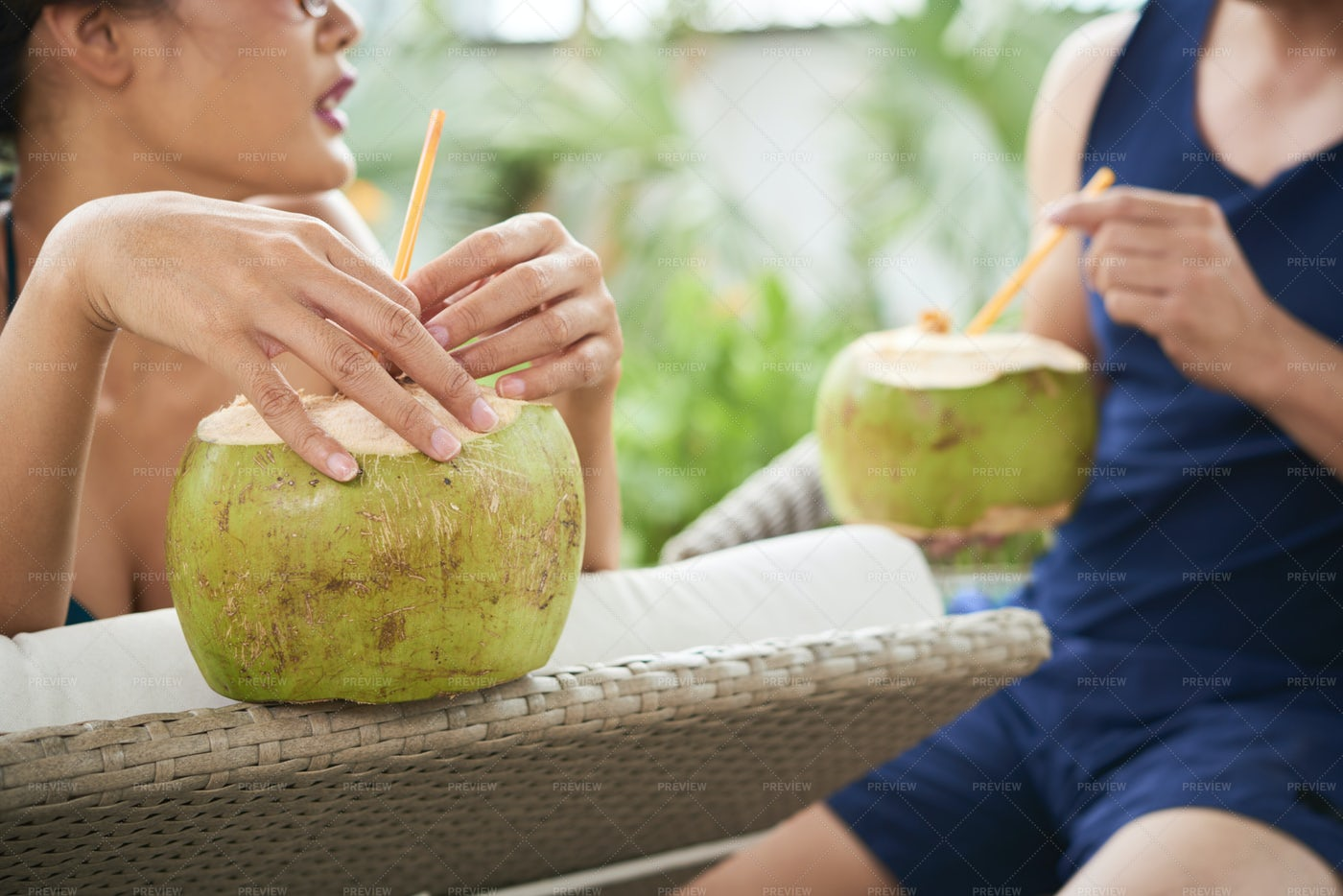 Couple Drinking Coconut Cocktail: Stock Photos