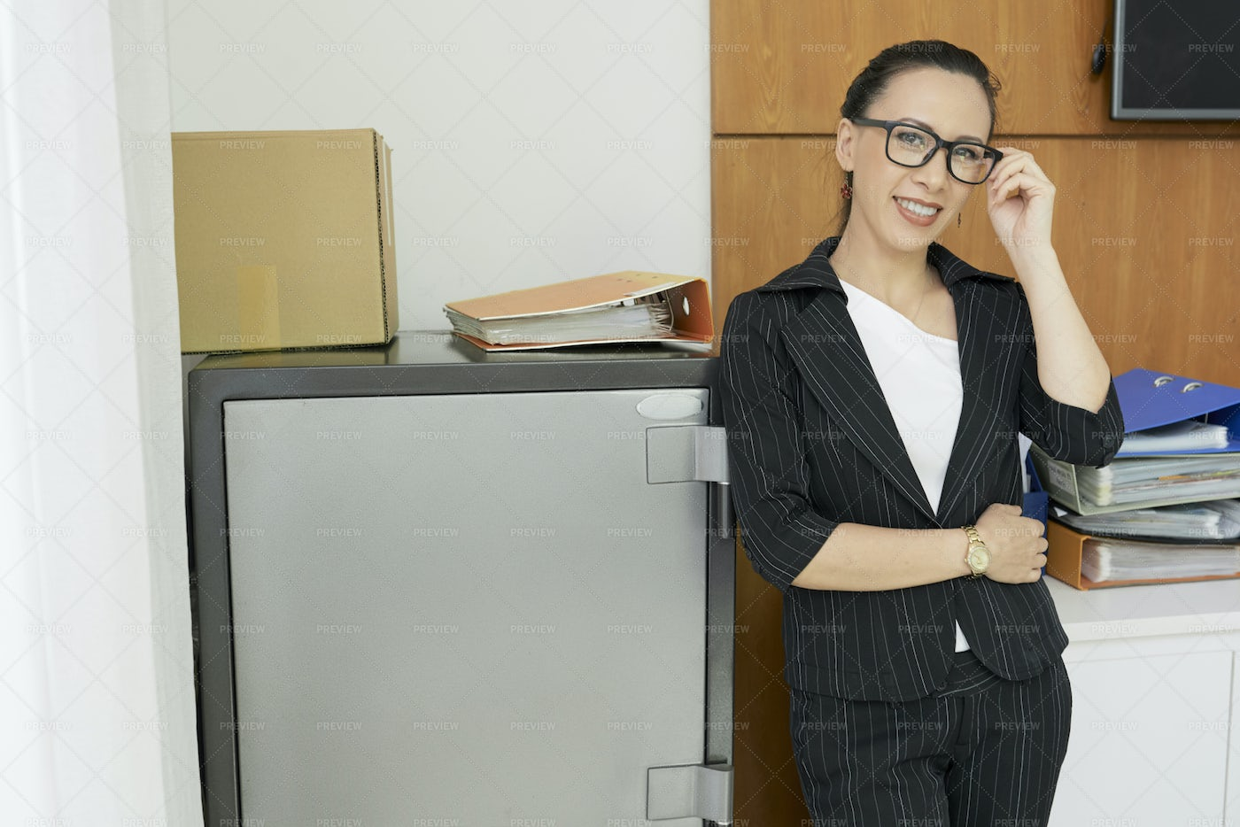Manager Standing Near The Safe At: Stock Photos
