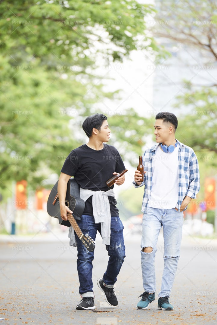 Teenagers Walking In The Park: Stock Photos