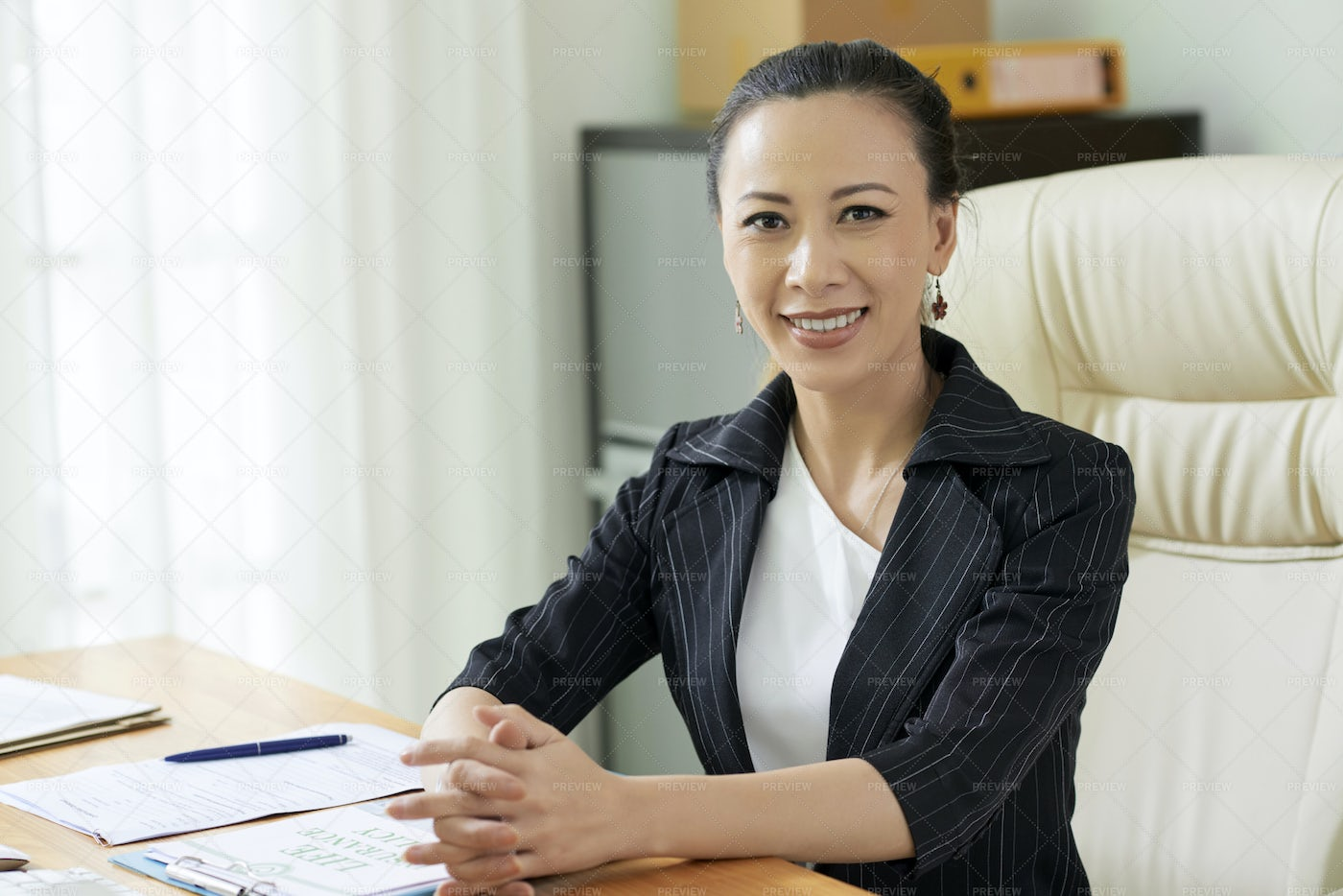 Successful Businesswoman Working At: Stock Photos