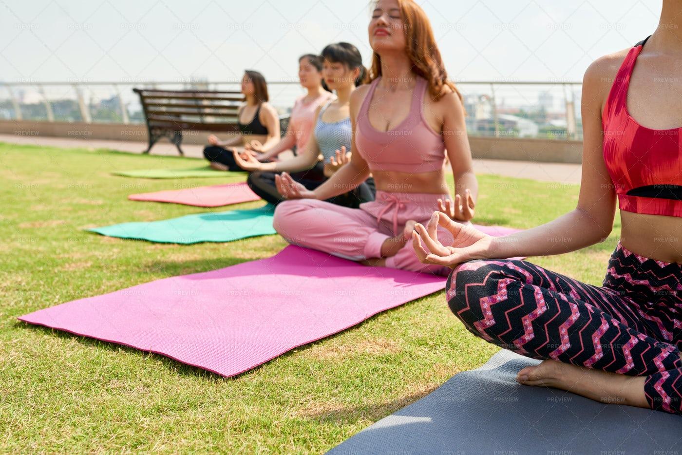 Meditating Sportswomen Outdoors In: Stock Photos