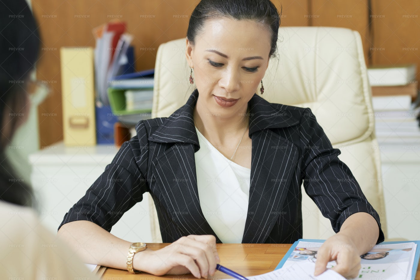 Businesswoman Working With Client: Stock Photos