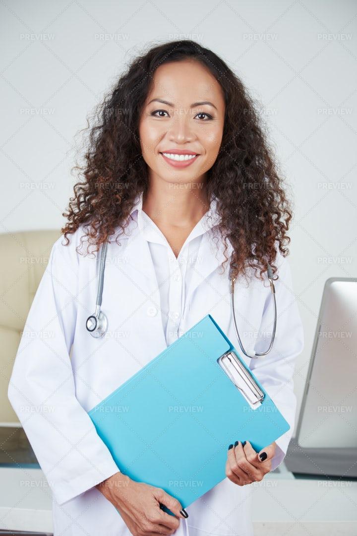 Smiling Young Vietnamese Doctor: Stock Photos