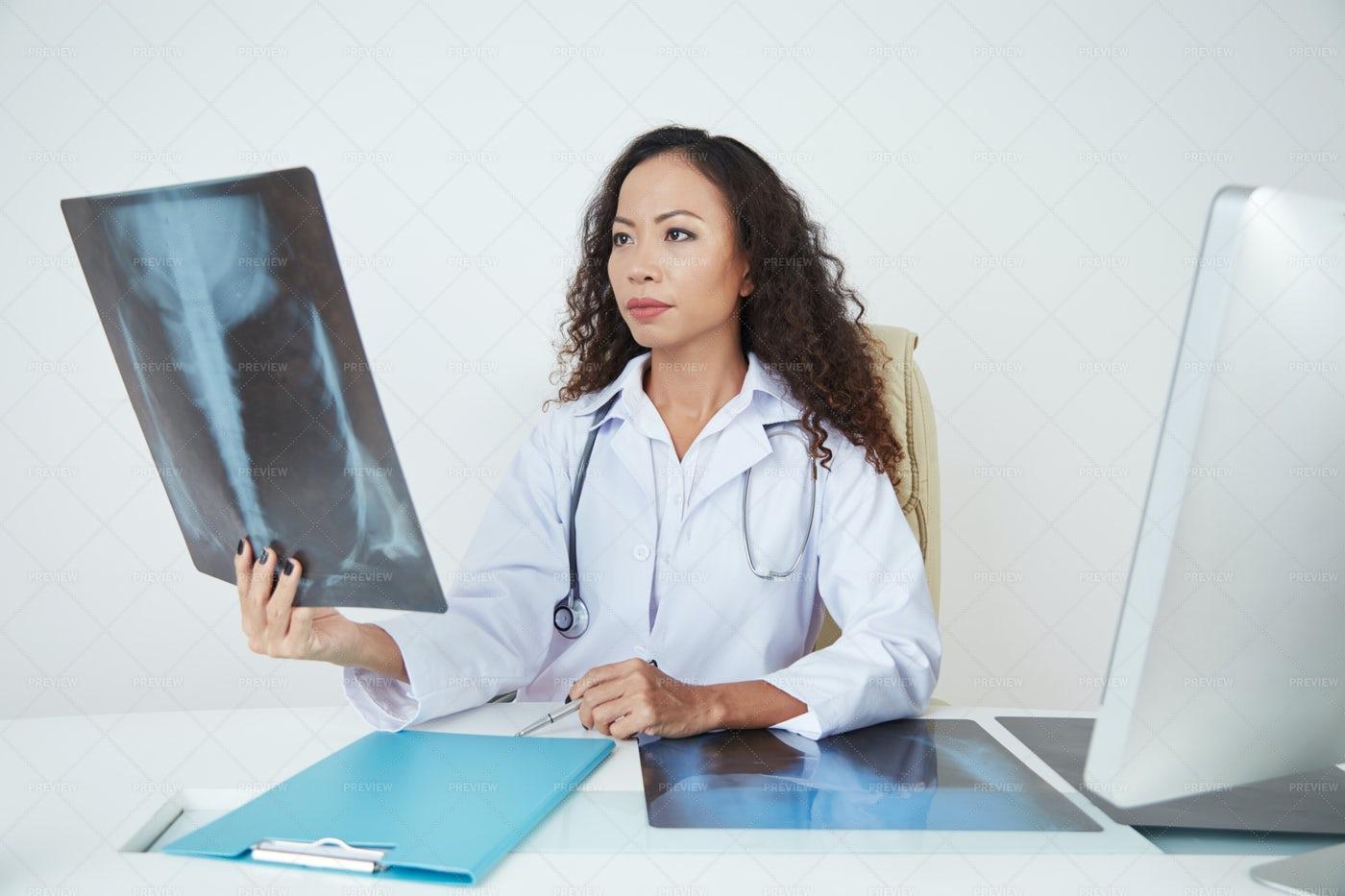 Doctor Examining Chest X-ray: Stock Photos