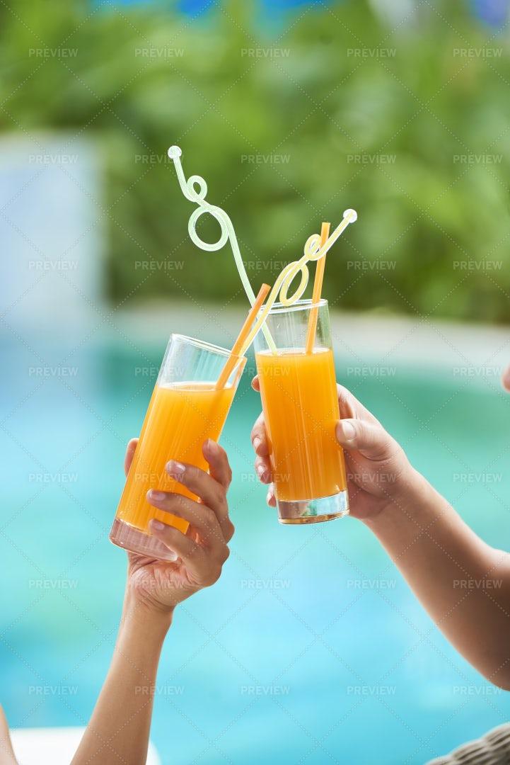 Couple Toasting With Juice: Stock Photos