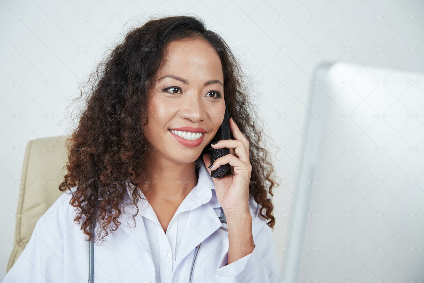 Doctor Consulting Patient On Phone: Stock Photos