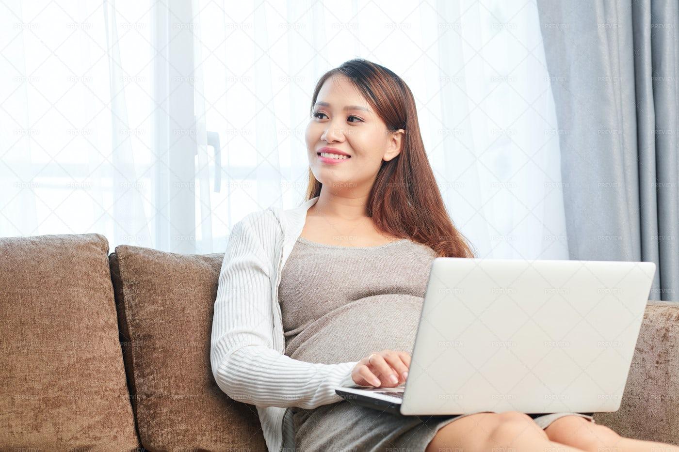 Pregnant Woman Working On Laptop: Stock Photos