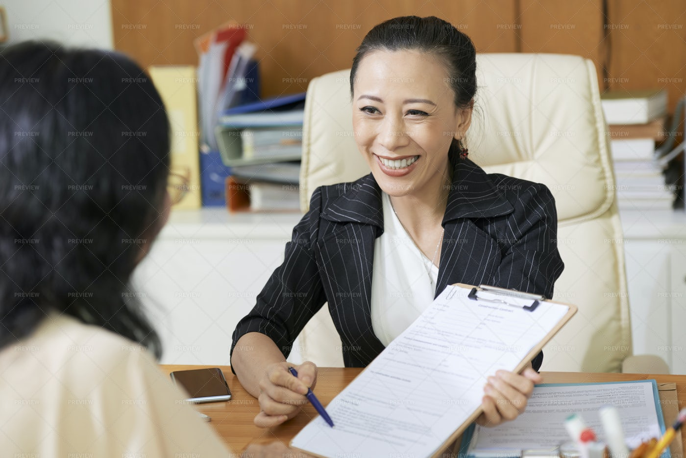 Partners Signing A Business Contract: Stock Photos