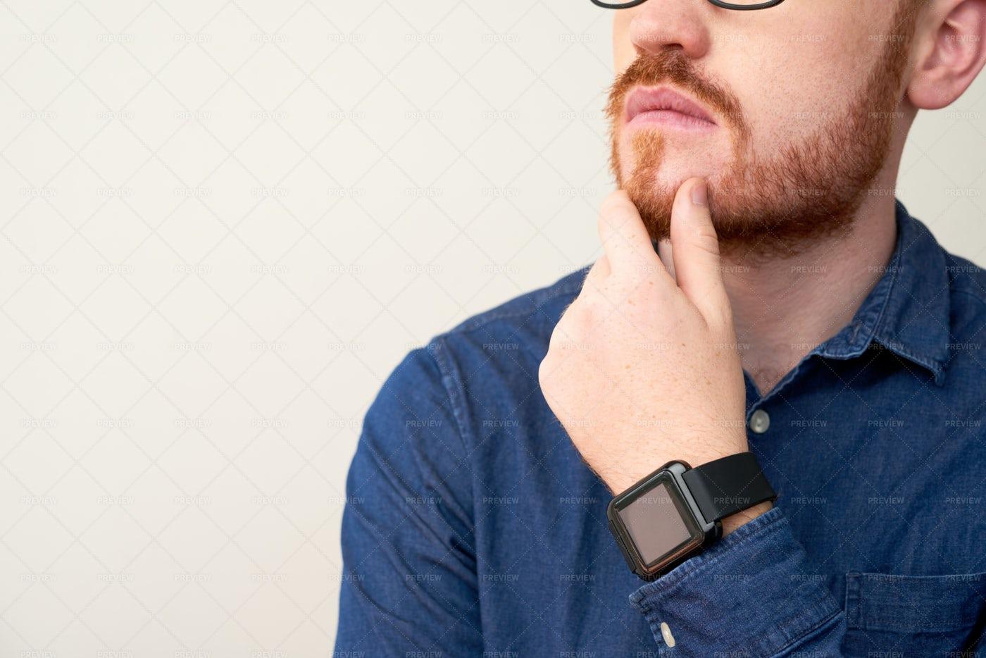Pensive Man Rubbing Chin: Stock Photos