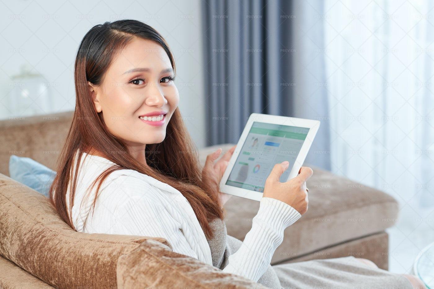 Cheerful Woman Checking Health App: Stock Photos