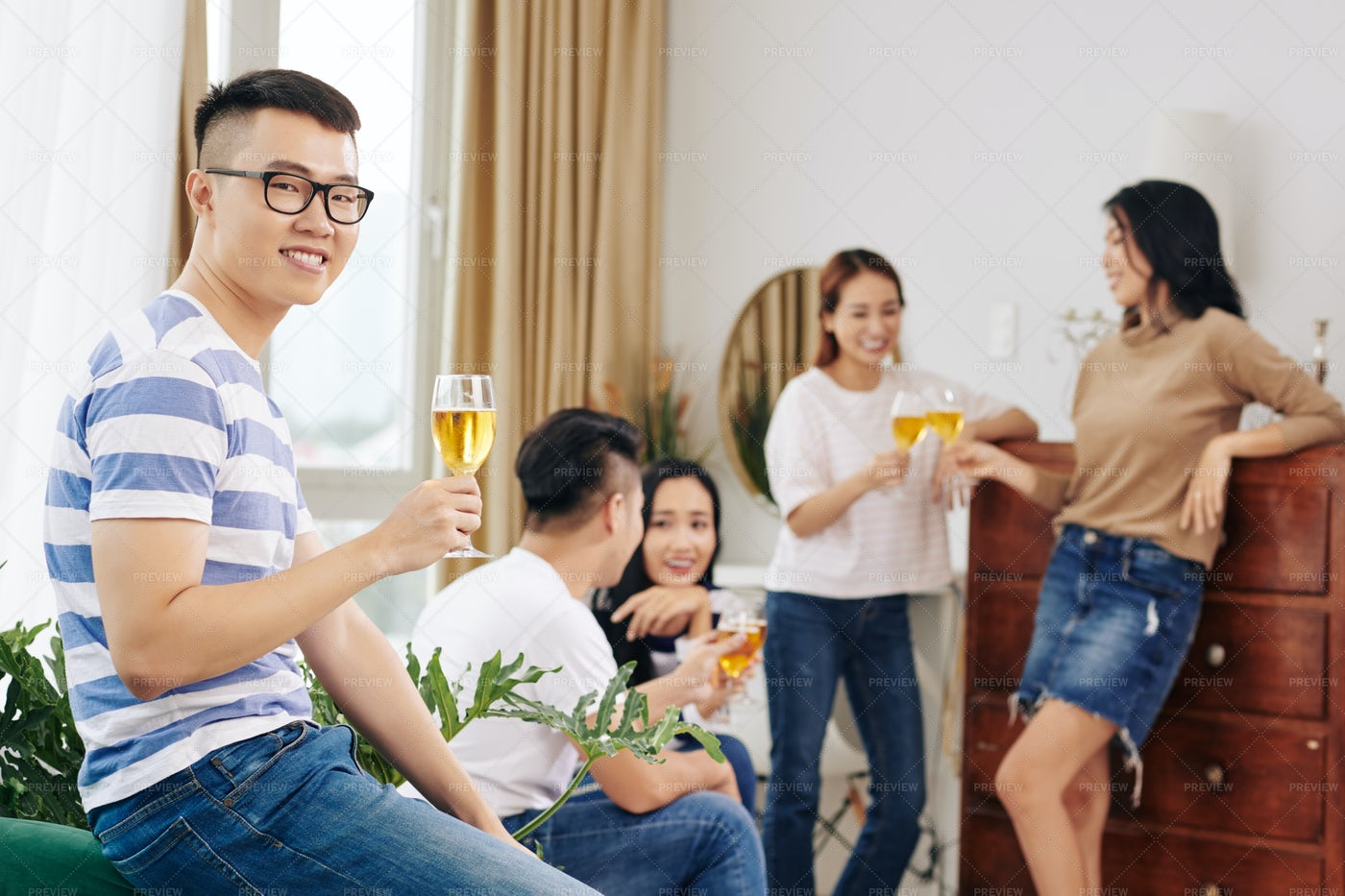 Young Man Partying With Friends: Stock Photos