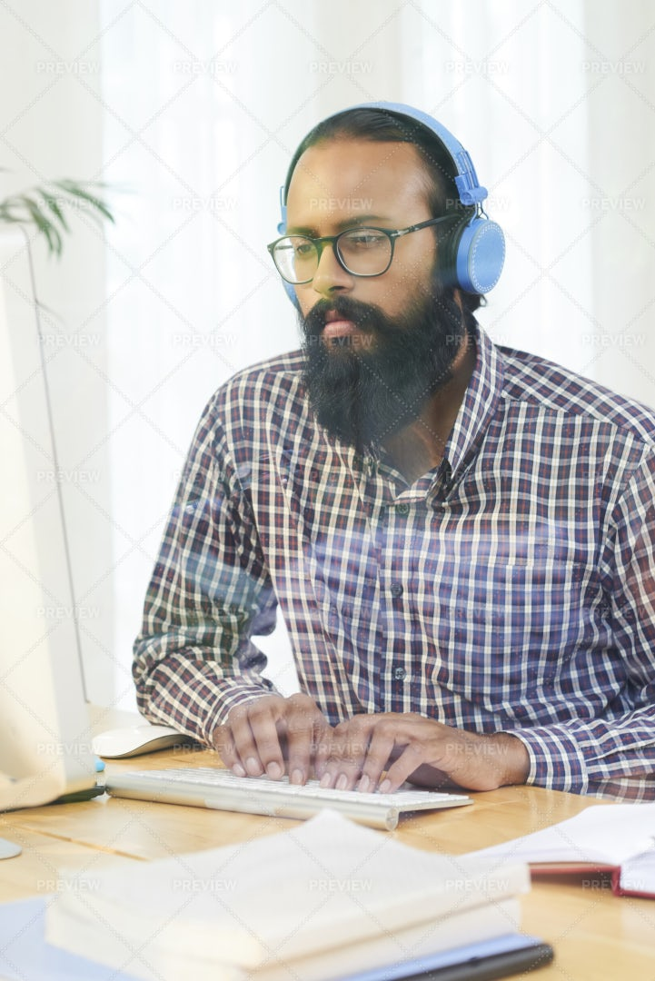 Businessman Typing On Computer At: Stock Photos