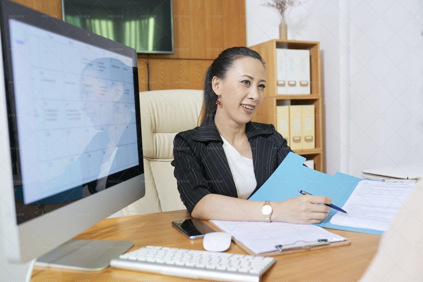 Businesswoman Working With Contract At: Stock Photos