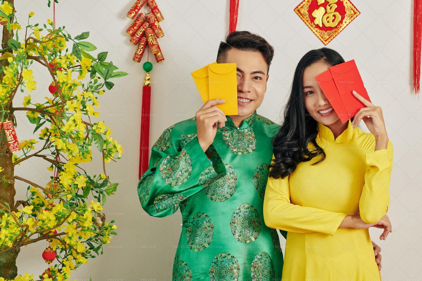 Couple With Lucky Money Envelopes: Stock Photos