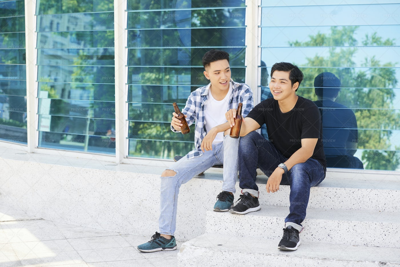 Teenagers Resting Outdoors With Beer: Stock Photos