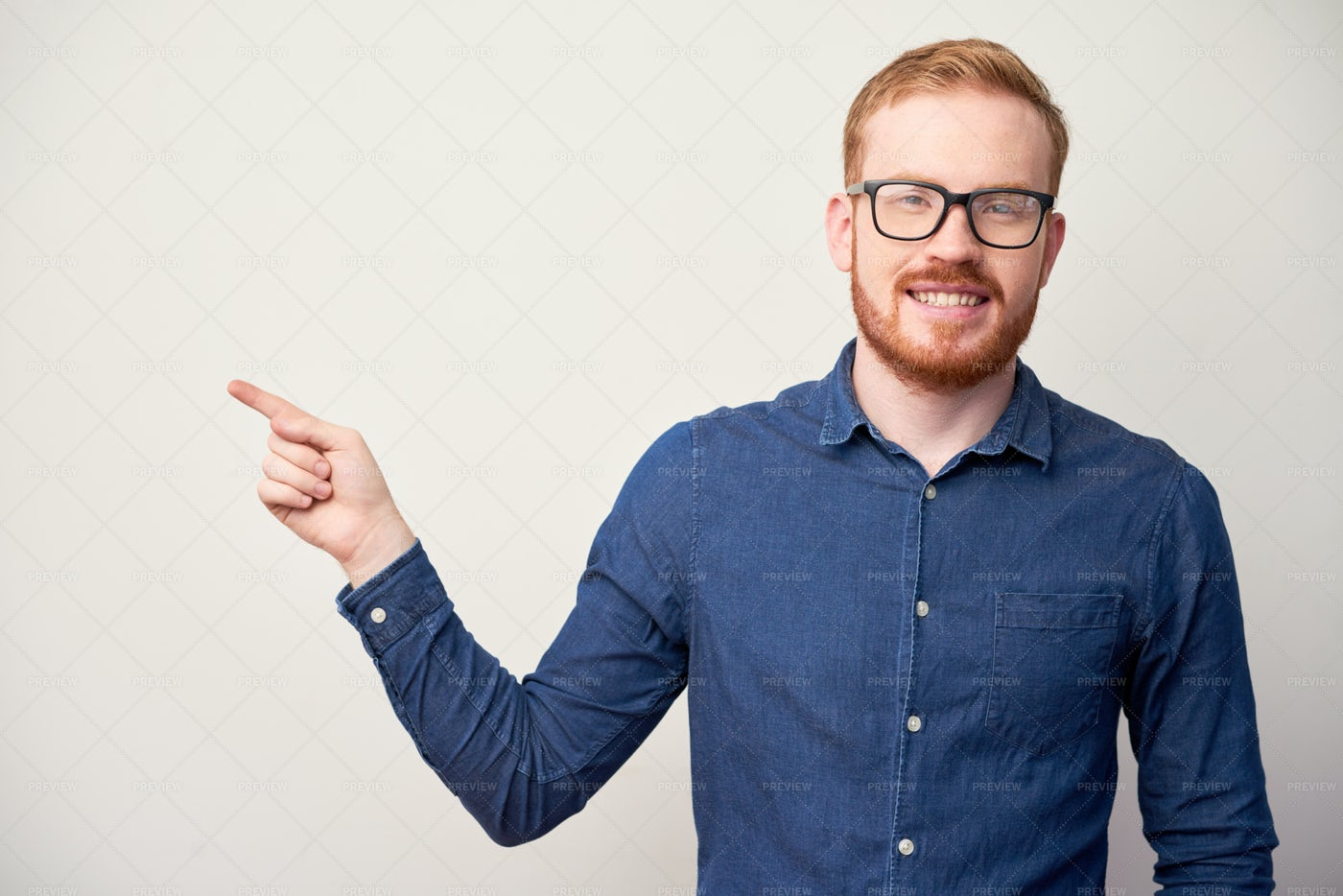 Happy Man Pointing With Finger: Stock Photos