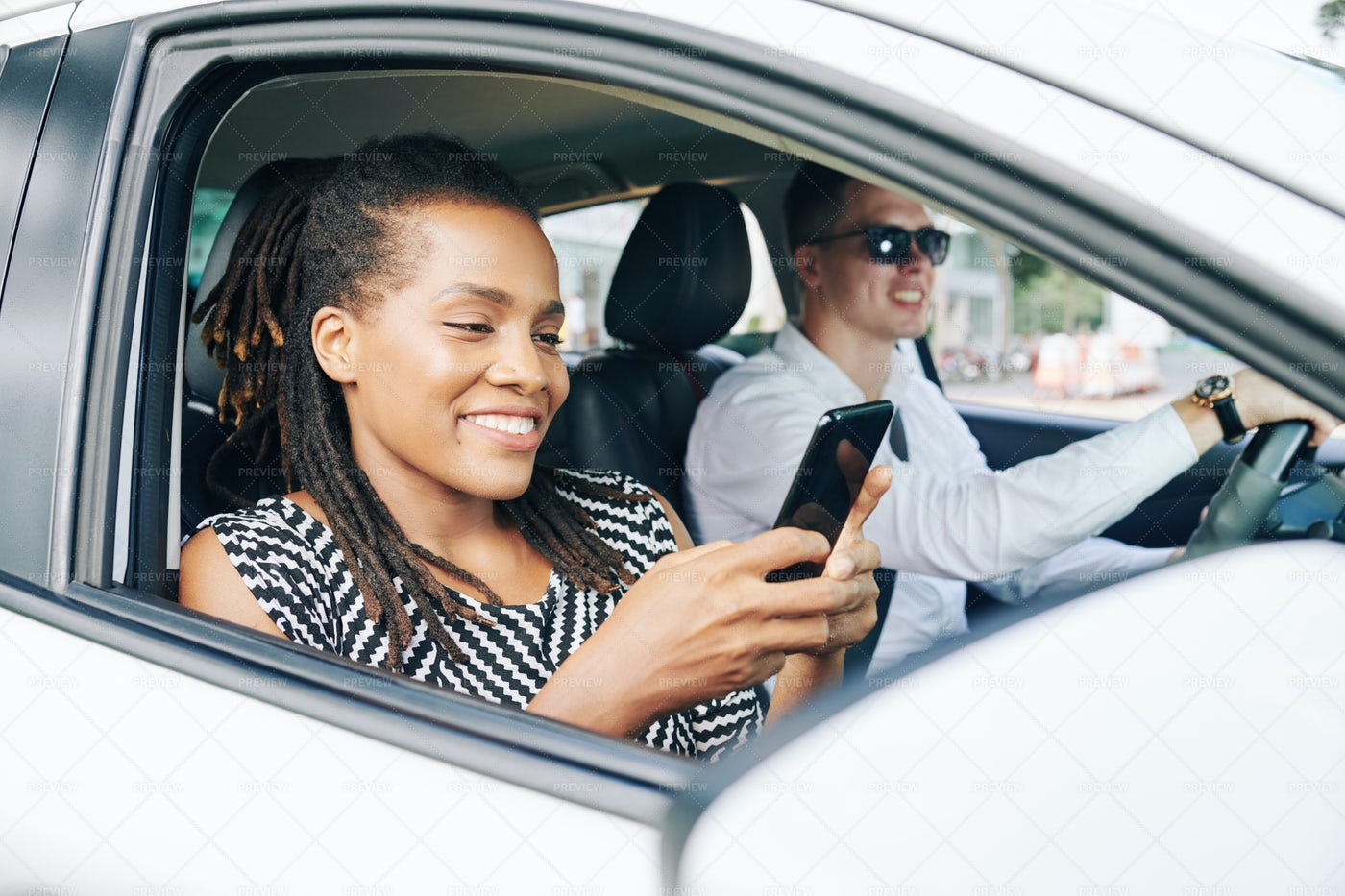 Young Couple Driving In Car In The City: Stock Photos