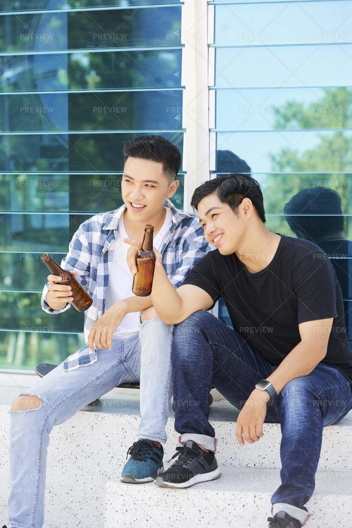 Men Drinking Beer In The City: Stock Photos