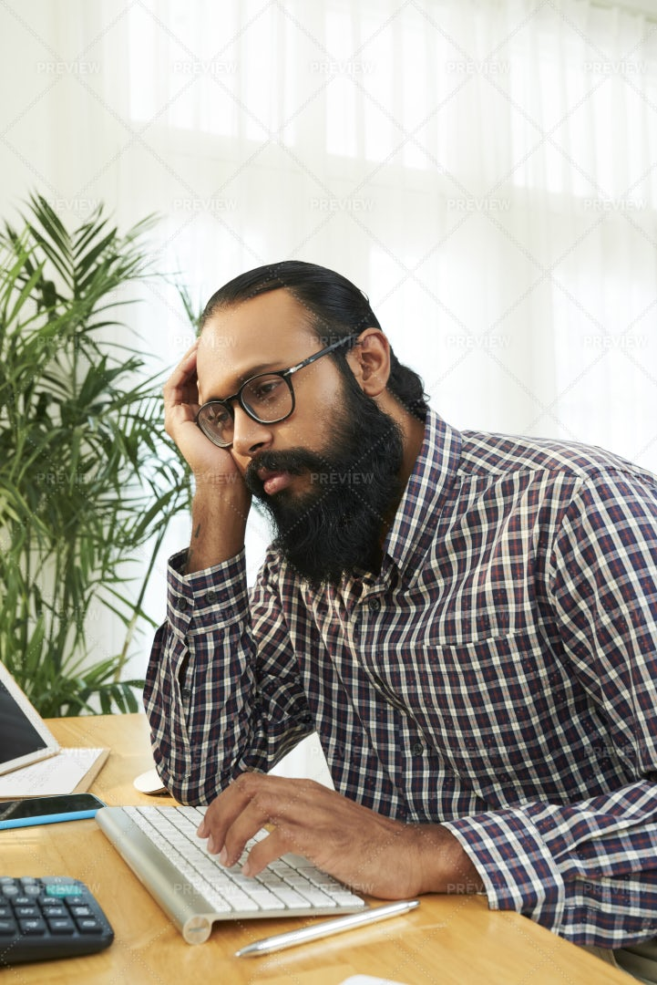 Tired Businessman Sitting At Workplace: Stock Photos