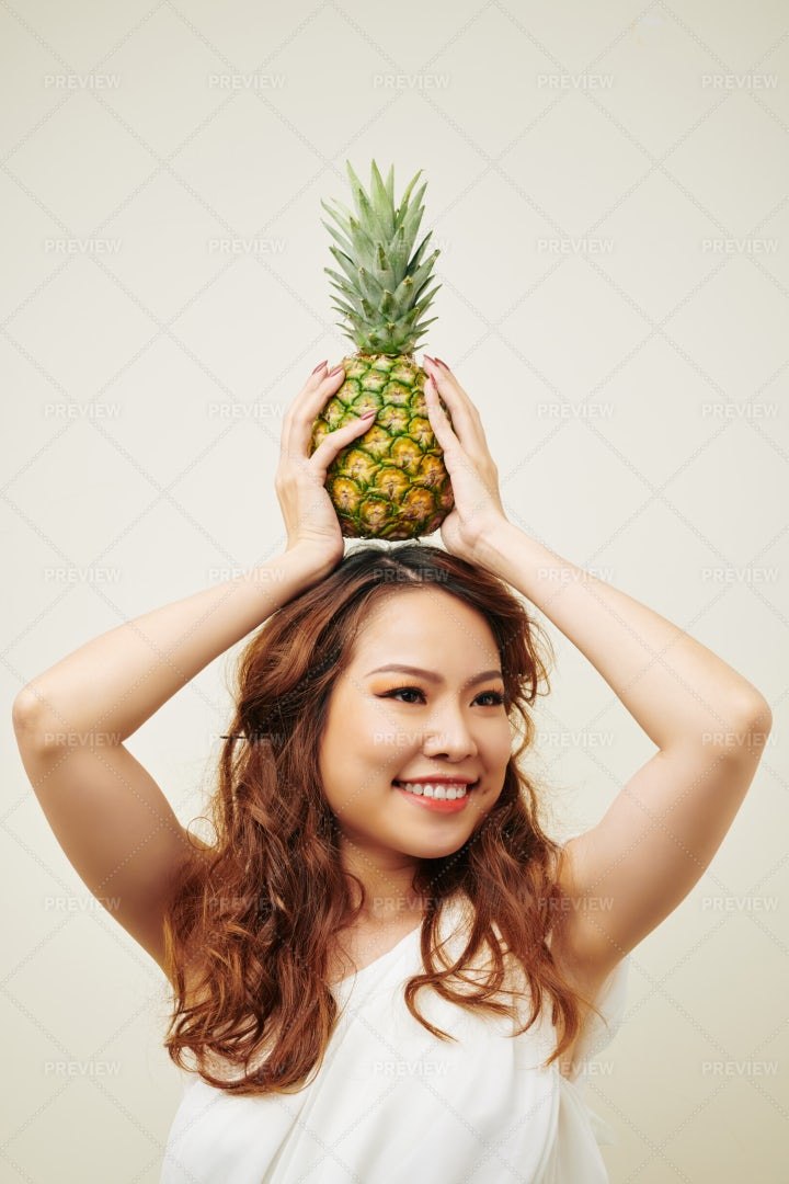 Asian Woman Posing With Pineapple: Stock Photos
