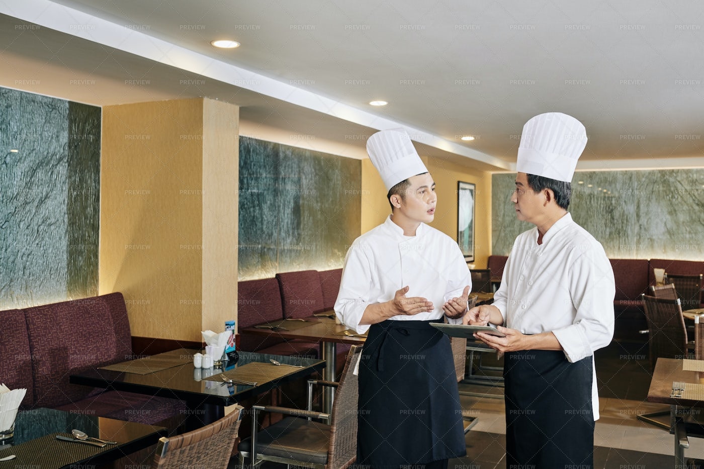 Two Chefs At The Restaurant: Stock Photos
