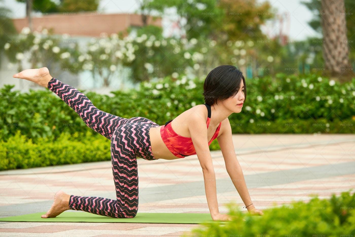 Fit Woman Training On Yoga Mat: Stock Photos