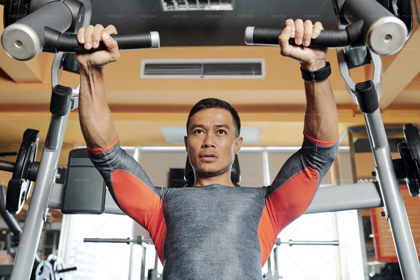 Strong Man Doing Chest Exercise: Stock Photos
