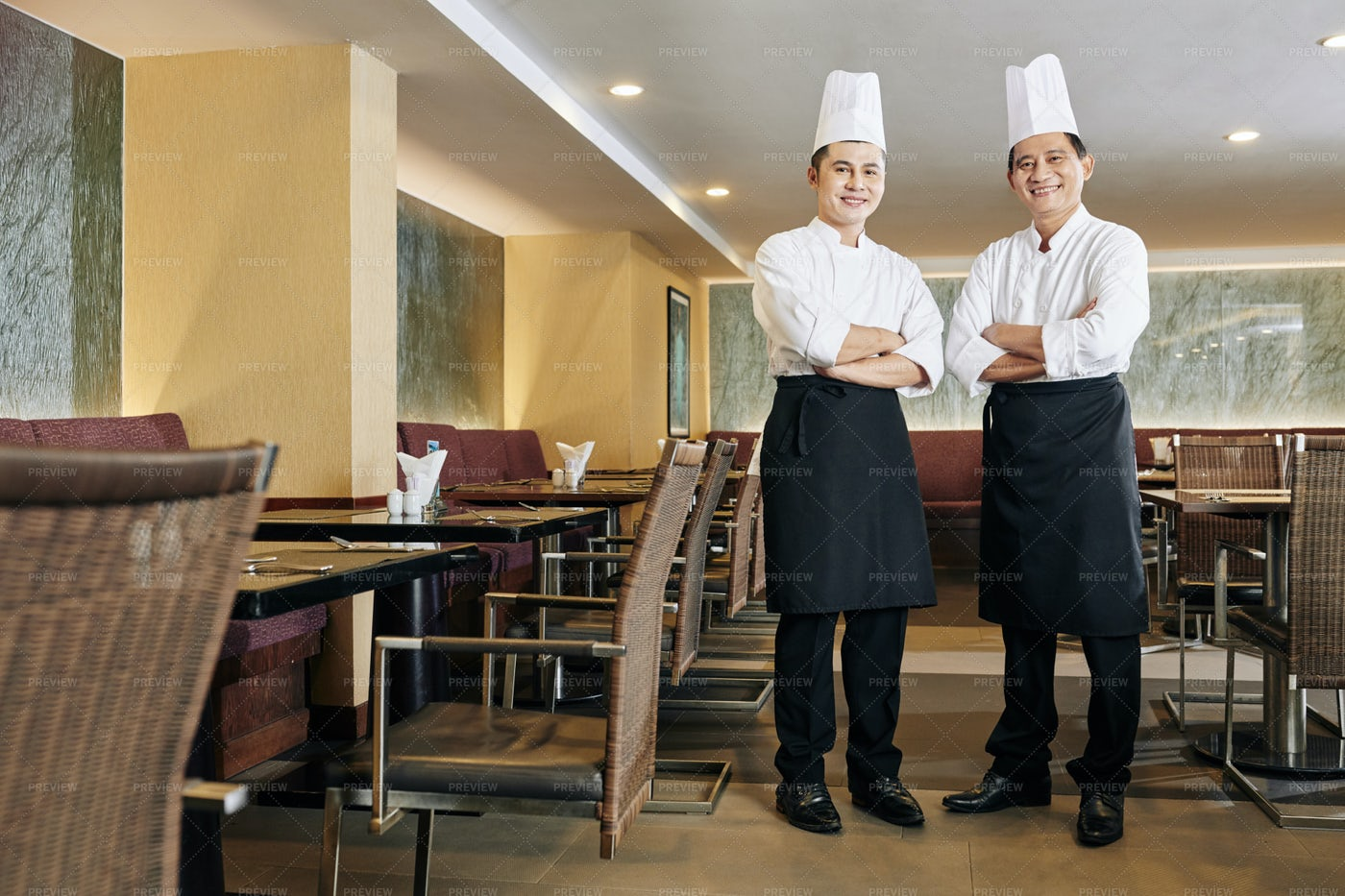 Two Successful Asian Chefs: Stock Photos