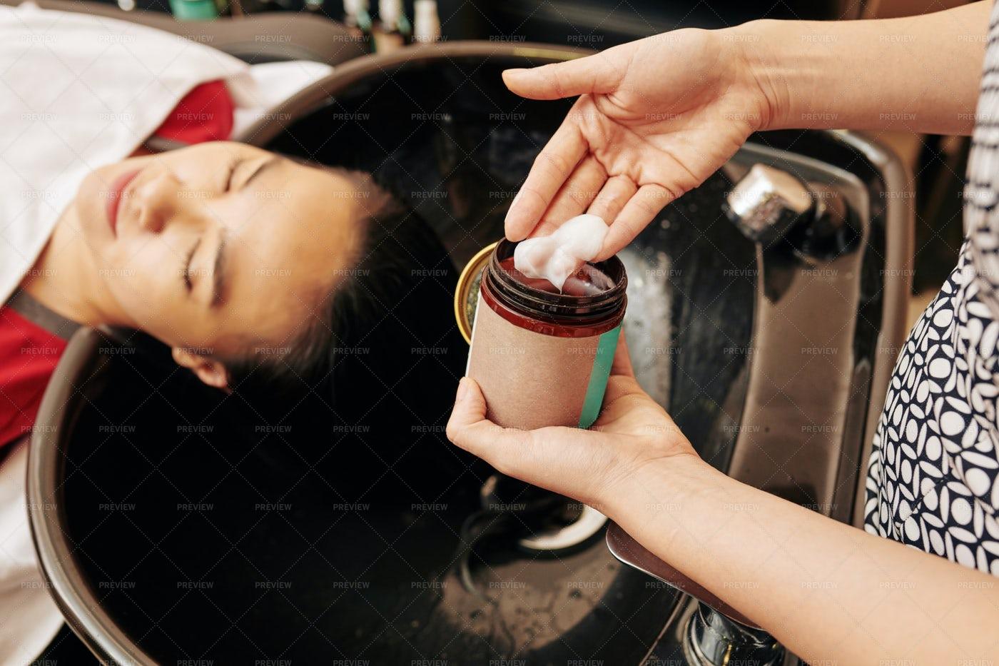 Hairdresser Applying Hydraiting Mask: Stock Photos