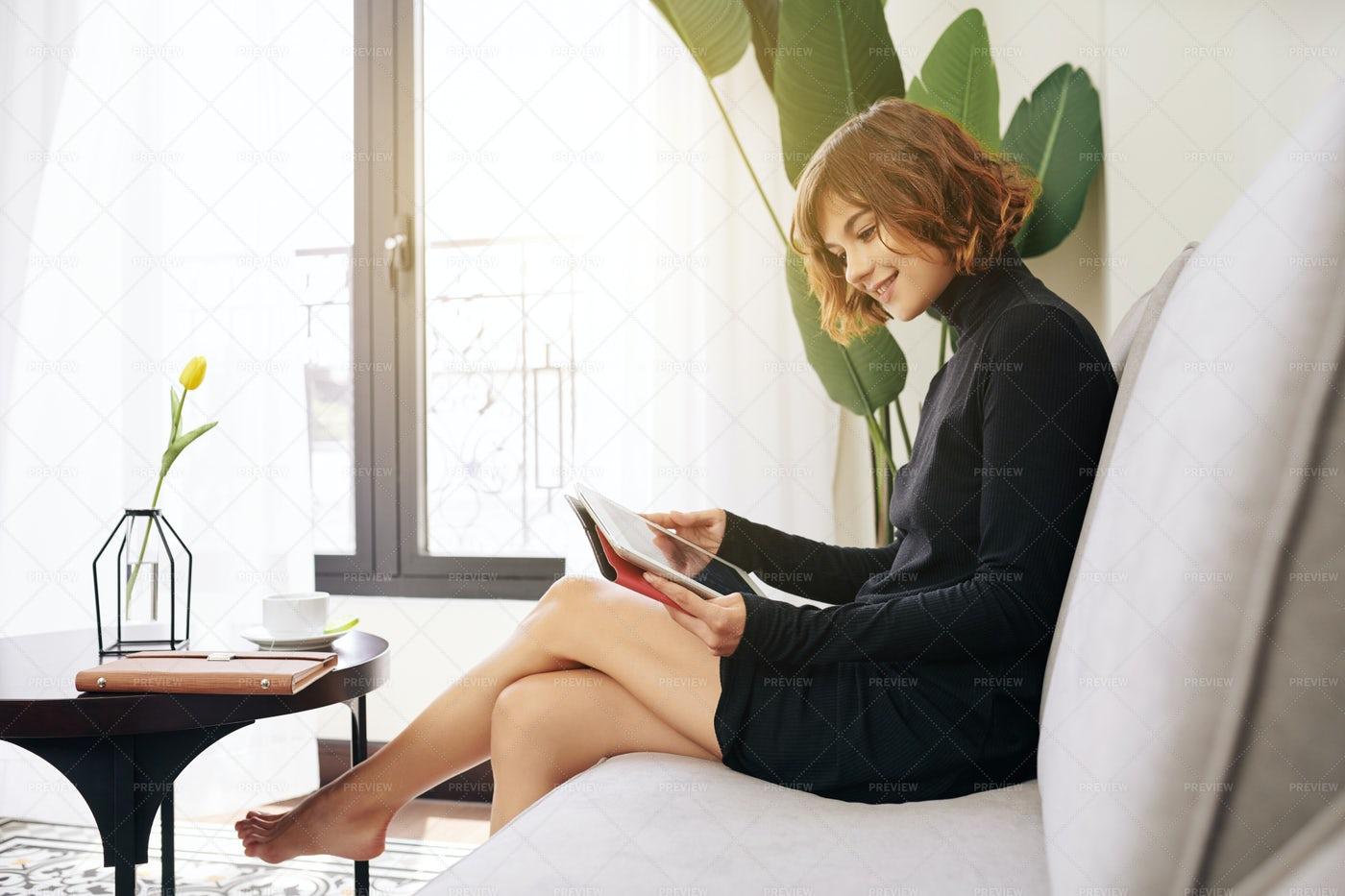 Pretty Woman Reading E-book: Stock Photos
