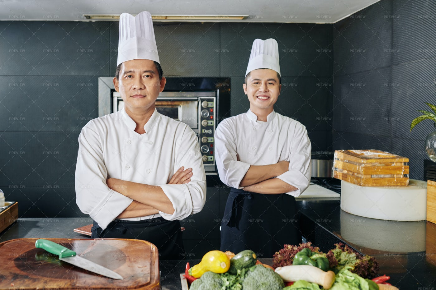 Two Chefs In The Kitchen: Stock Photos