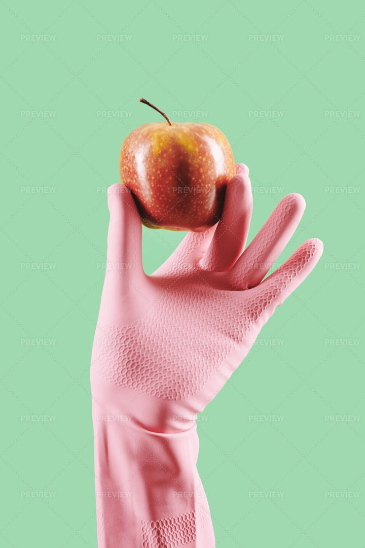 Gloved Hand With Red Apple: Stock Photos