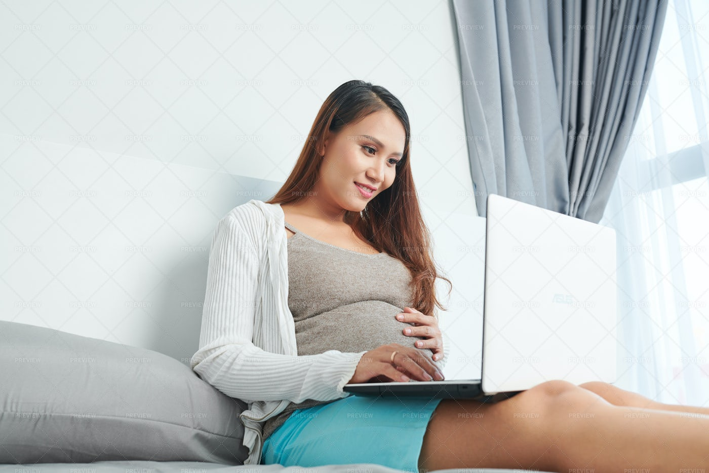 Woman Reading About Pregnancy: Stock Photos