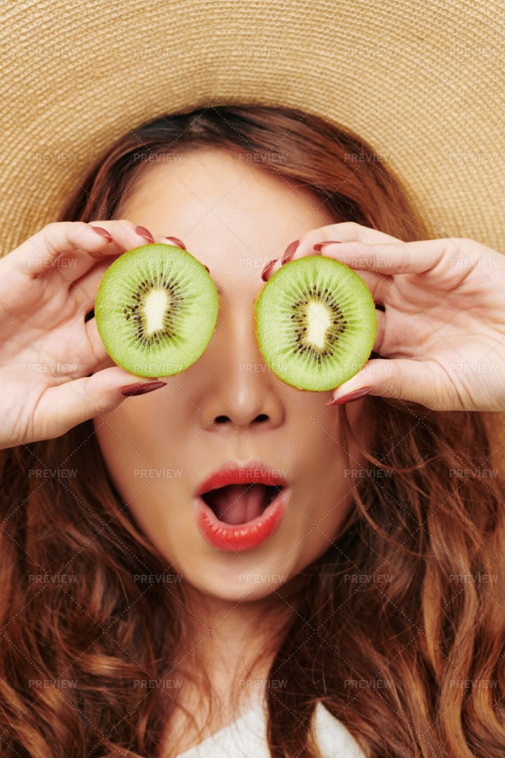 Red Haired Woman With Kiwi: Stock Photos