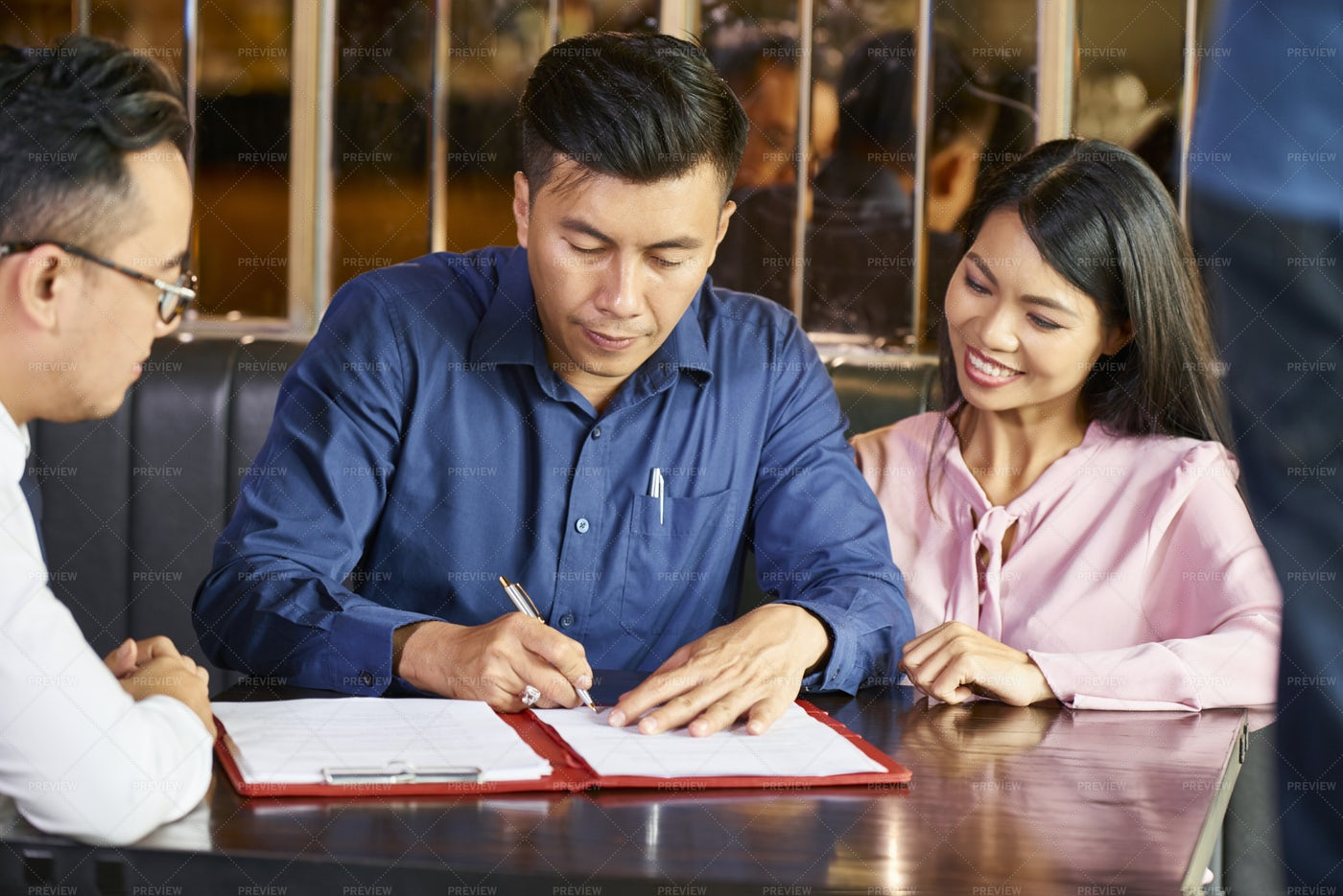 Signing Contract With Real Estate Agent: Stock Photos