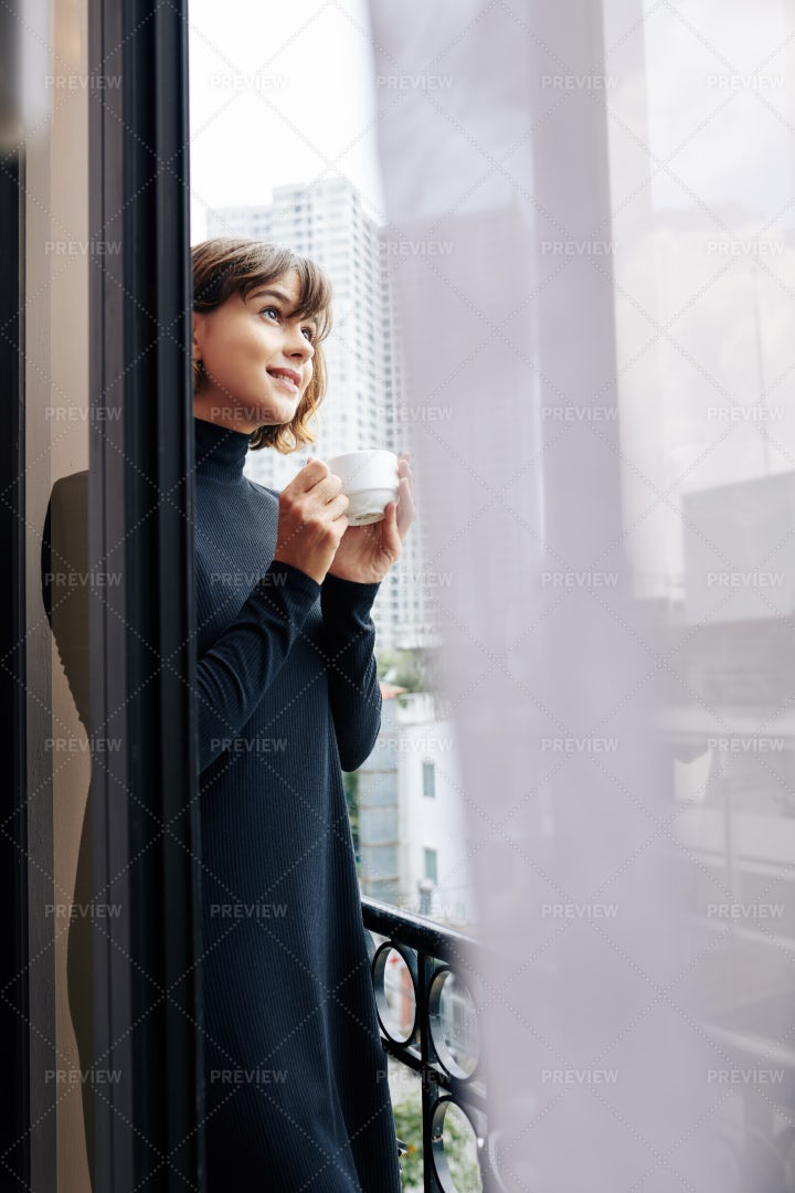 Pretty Woman Enjoying Morning Coffee: Stock Photos