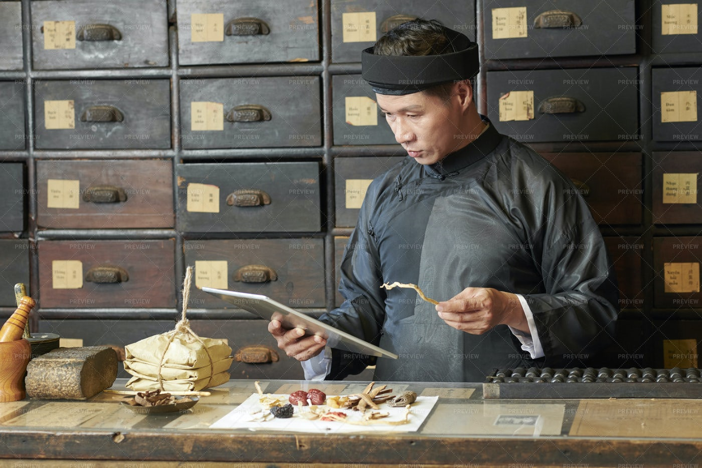 Asian Medicine Practitioner With Tablet: Stock Photos