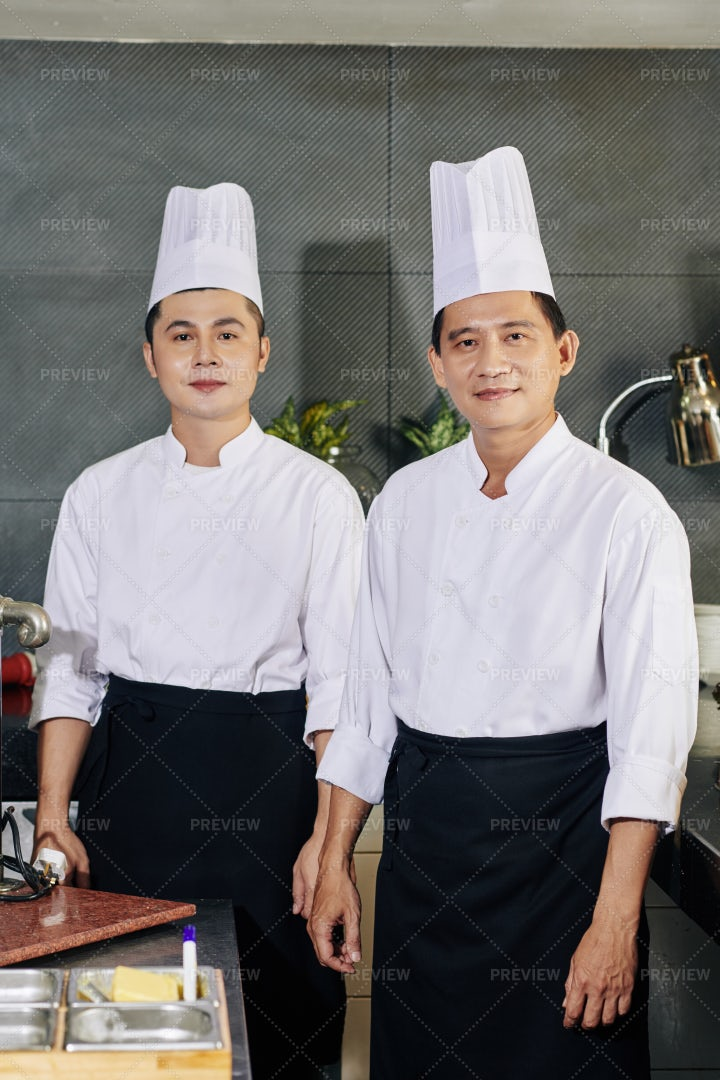 Asian Chef And His Assistant: Stock Photos