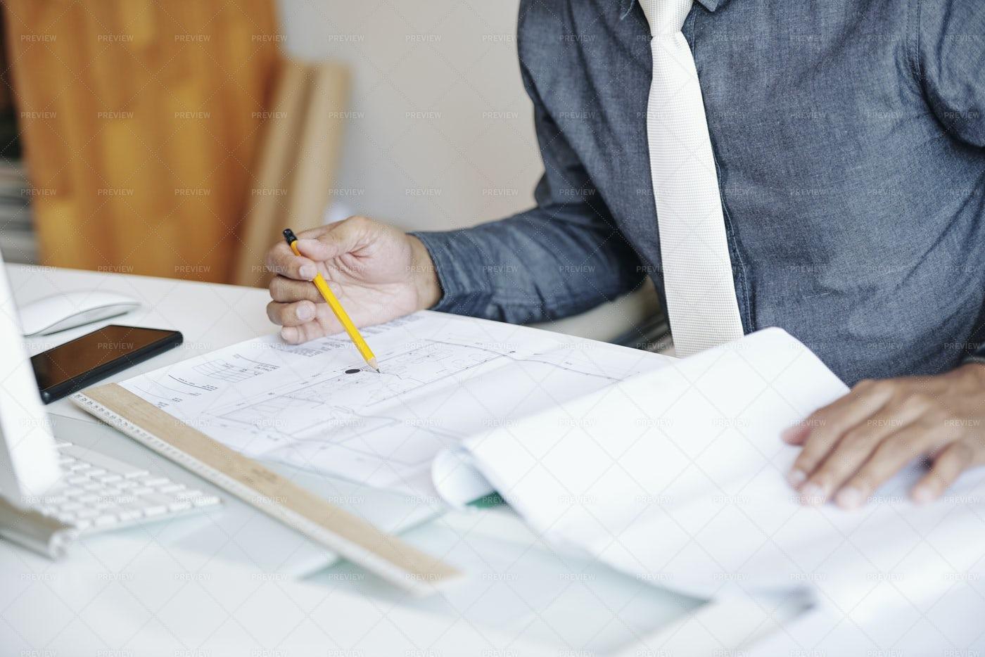 Engineer Examining Blueprint: Stock Photos