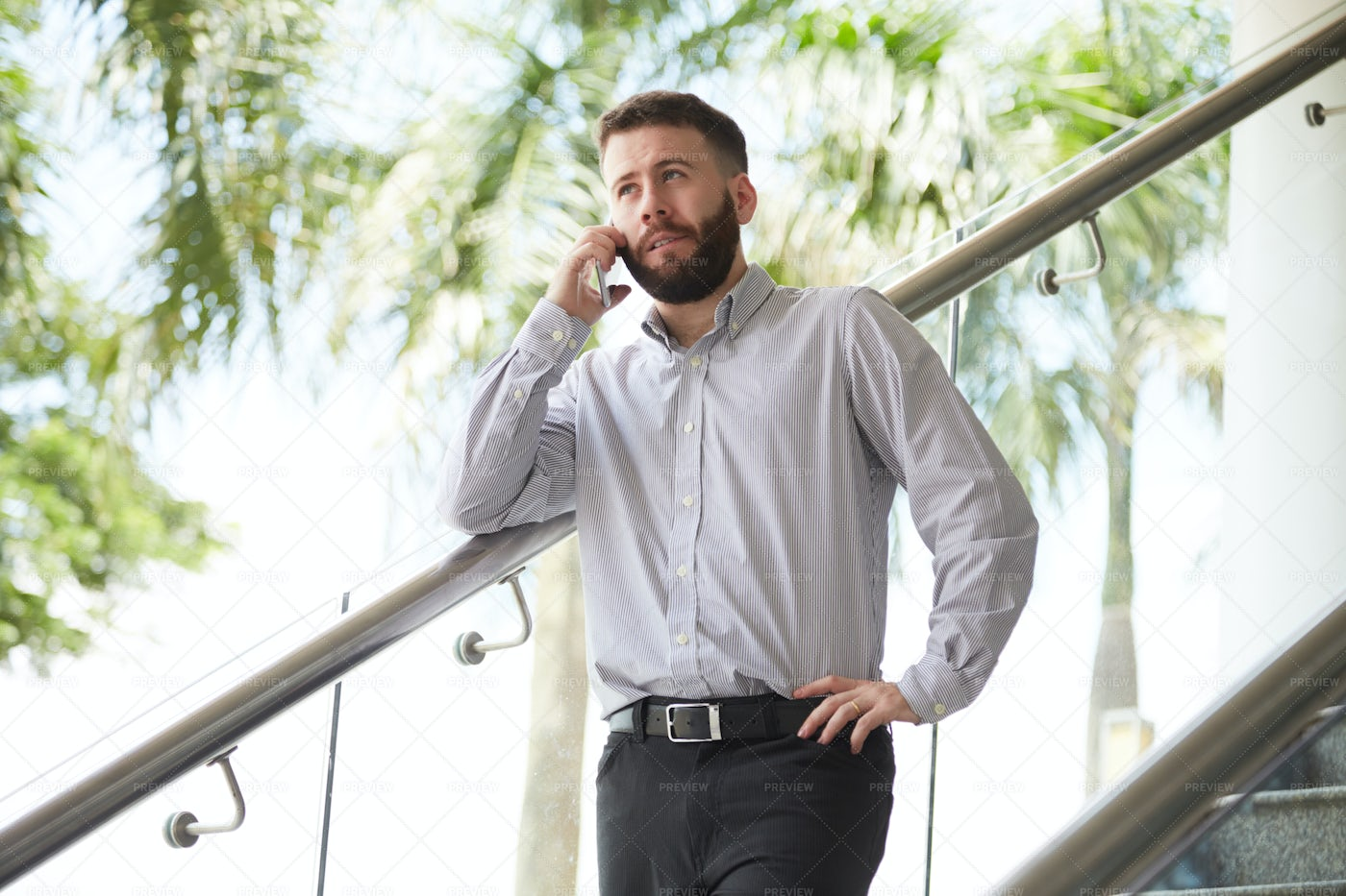 Manager Talking On Mobile Phone: Stock Photos