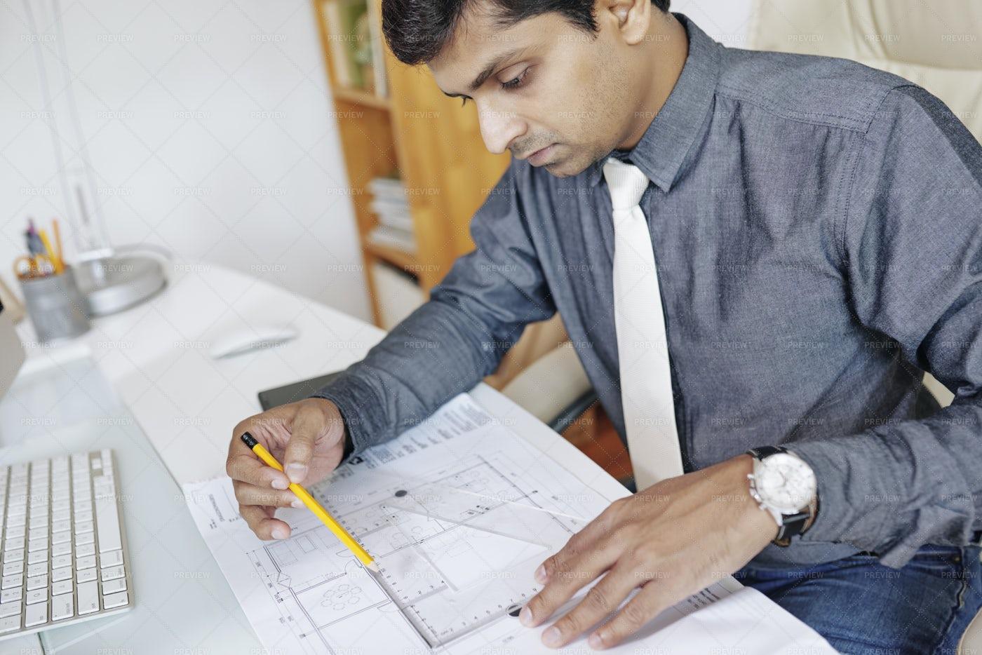 Engineer Measuring Blueprint: Stock Photos