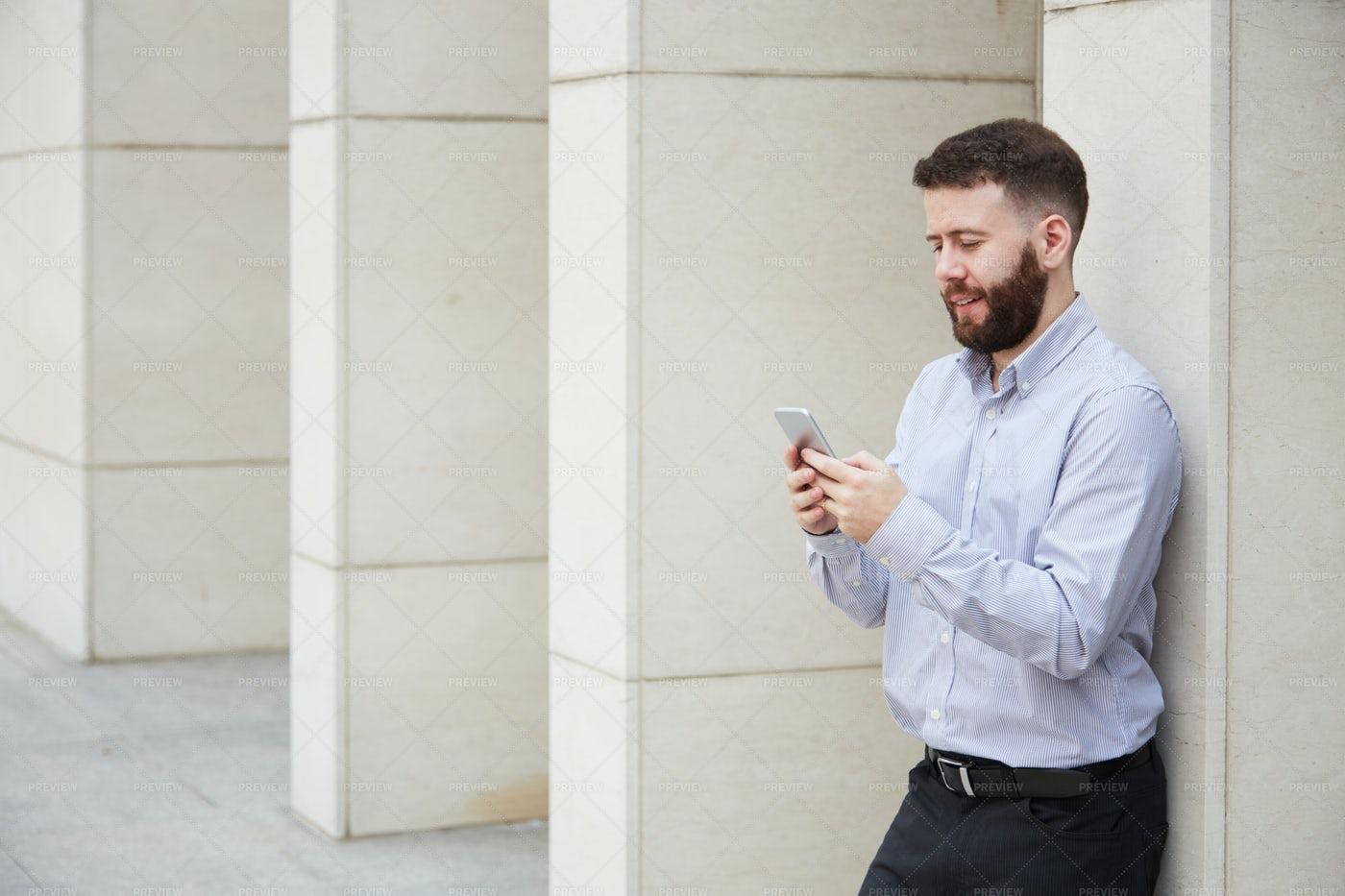 Businessman Using Mobile Phone Outdoors: Stock Photos