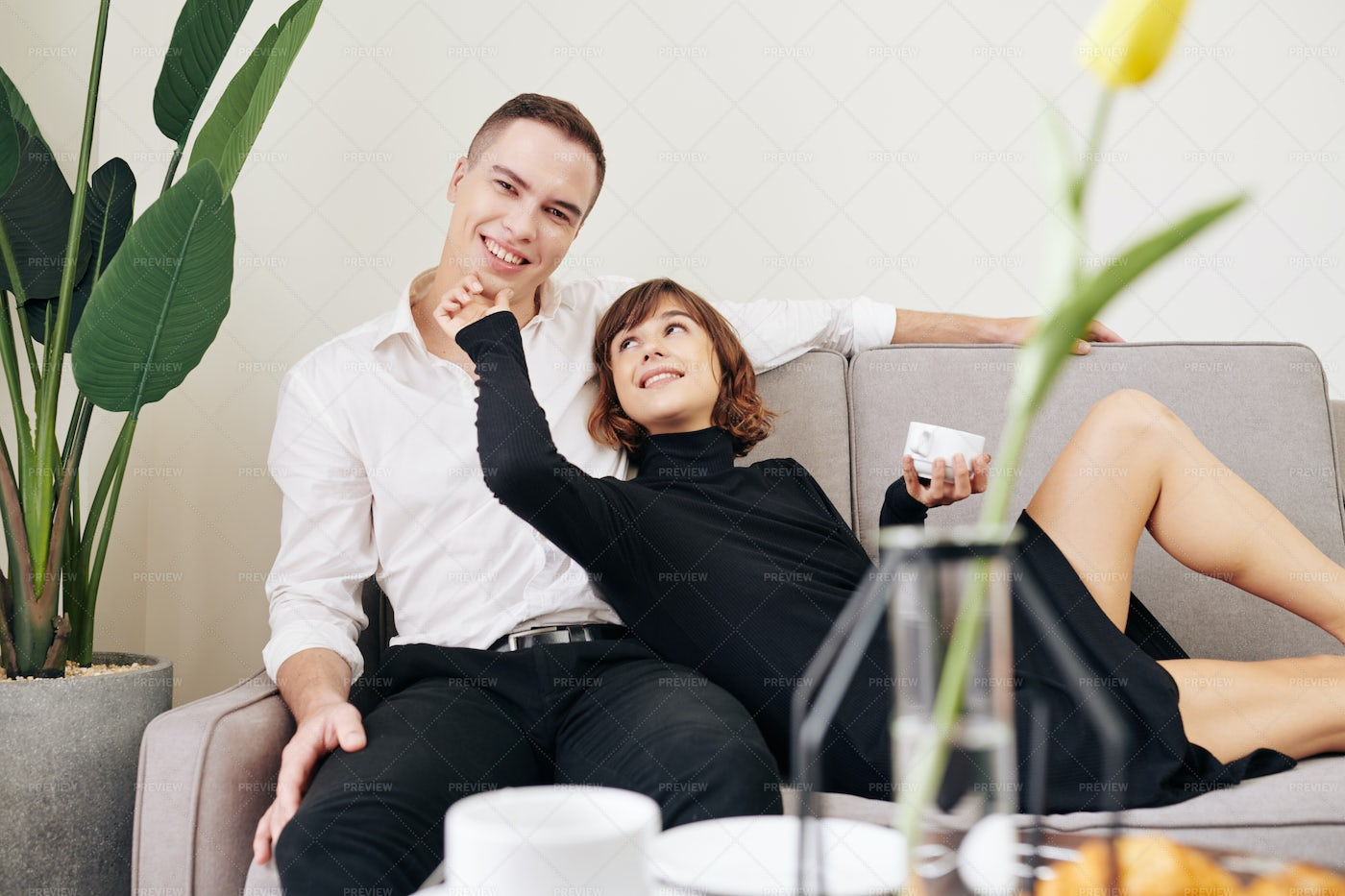 Happy Couple In Love Resting At Home: Stock Photos