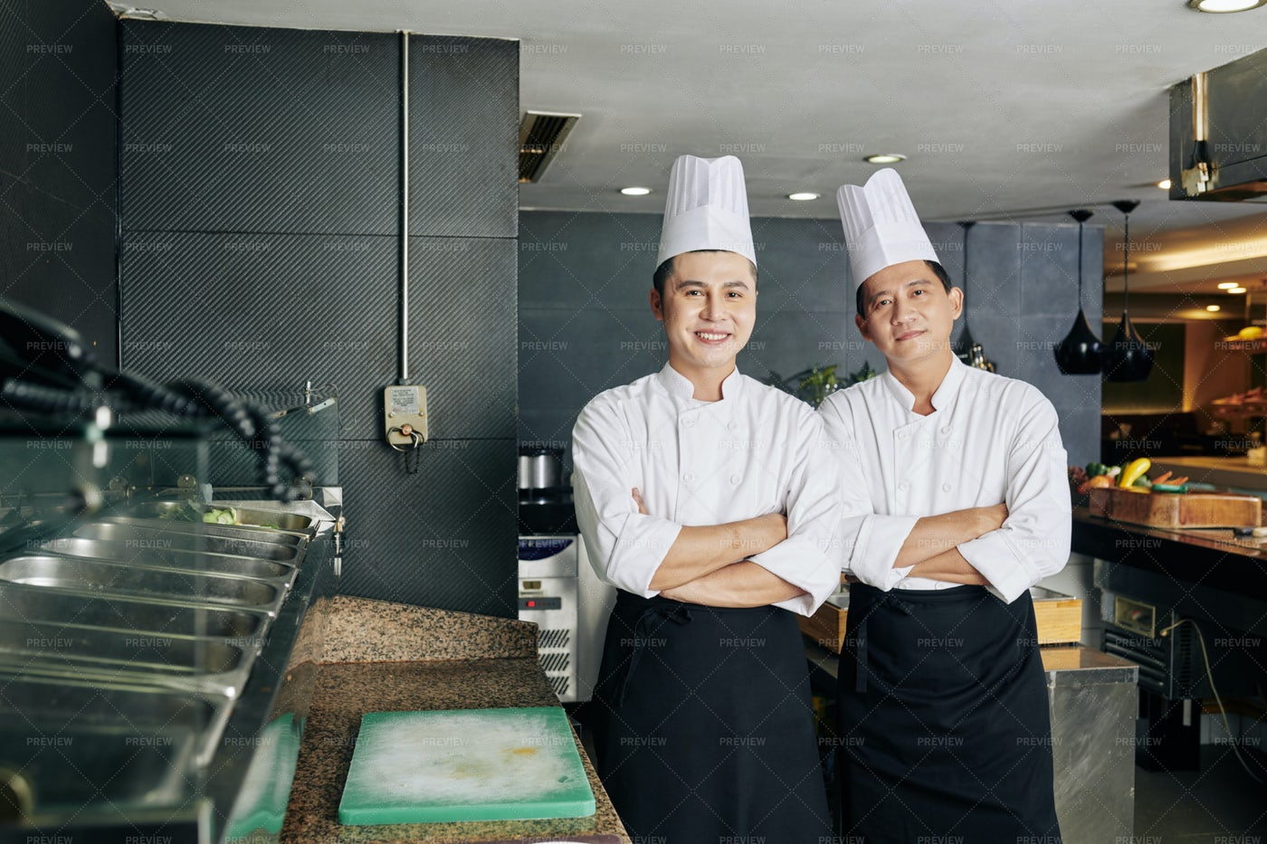 Two Colleagues Working In The Kitchen: Stock Photos