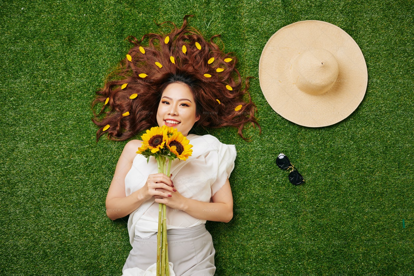 Woman With Sunflowers On The Grass: Stock Photos