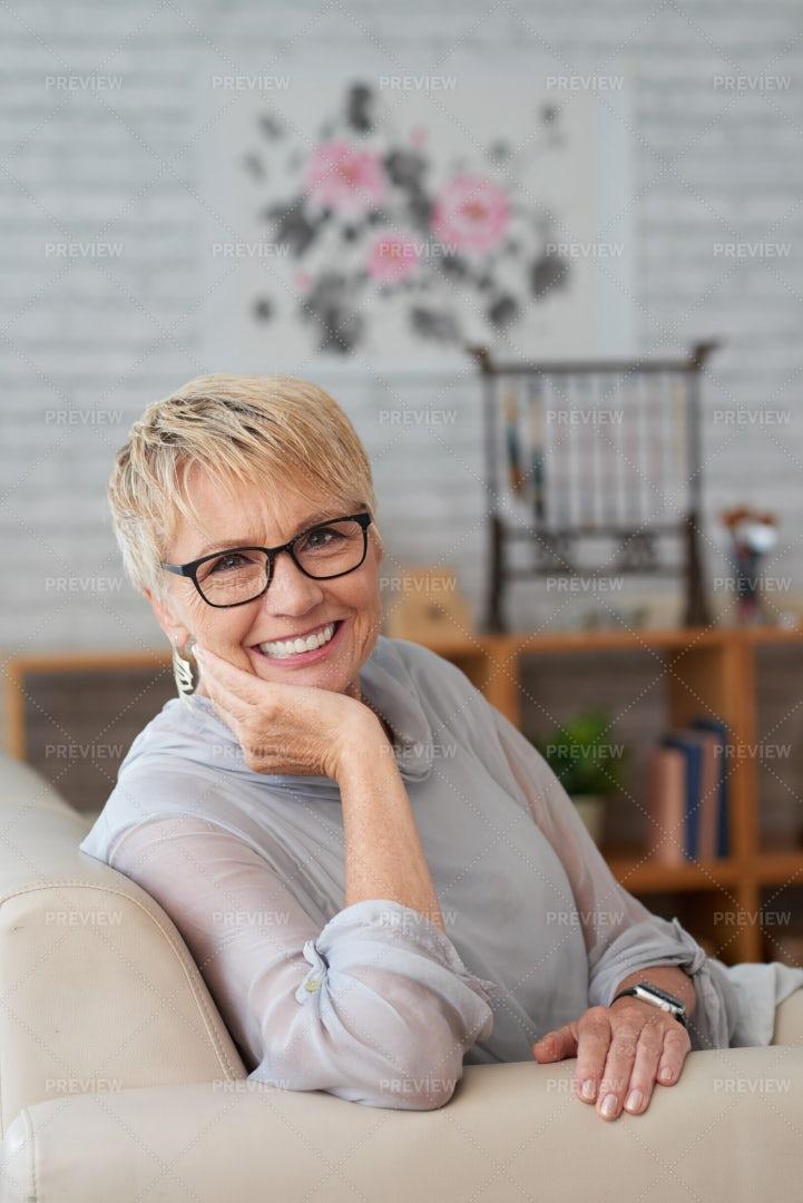 Mature Woman Sitting At Home: Stock Photos
